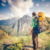 hiker-backpack-mountains